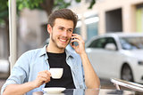 Man talking on the mobile phone in a coffee shop