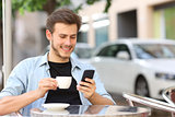 Man using a smart phone in a coffee shop