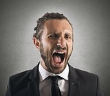 Furious businessman screaming