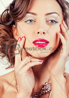 beauty young luxury woman with jewellery, rings, nails close up on white