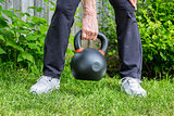 kettlebell workout in backyard