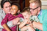 Parents Kissing Their Children