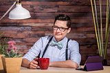 Butch Businesswoman with Coffee Mug