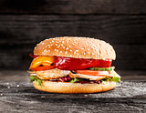Burger with chicken and vegetables