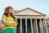 Happy woman tourist standing by Pantheon in Rome in summer