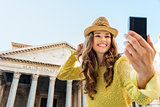 Closeup of woman taking selfie at Pantheon cheering