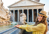 Smiling woman tourist at the Pantheon fountain in Rome