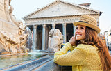 Happy woman tourist at the Pantheon fountain in Rome