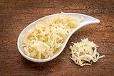 bowl of sauerkraut against rustic wood
