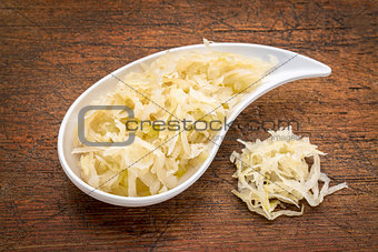 bowl of sauerkraut against rustic wood