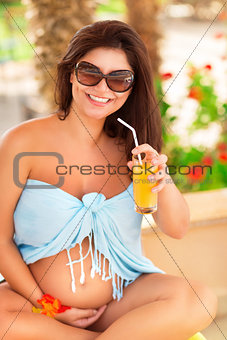 Pregnant woman on tropical resort