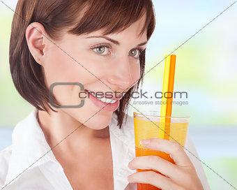 Beautiful woman drinking juice