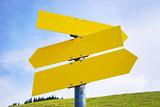 Three yellow empty arrow signs