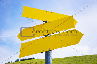 Three yellow empty arrow signs