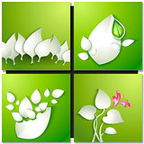Vector paper leaves on green background