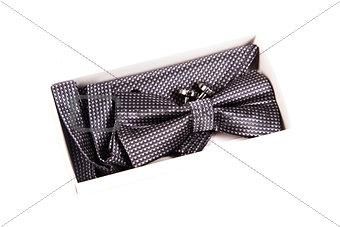 Bow tie, handkerchief and cufflinks. Wedding accessories groom.
