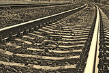 Railroad track into sepia