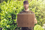 Cute guy with a happy grin making a delivery