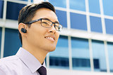 Business Man With Bluetooth Handsfree Device Text Space