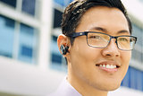 Headshot Business Man With Bluetooth Handsfree Device