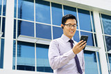 Businessman Talking Video Call On Mobile With Bluetooth Headset