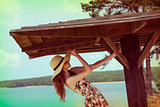 playing girl ner lake with summer hat