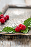 Leaves and ripe raspberries.