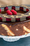 Cake with chocolate icing and raspberries