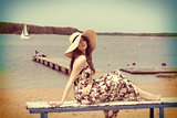 vintage color effect summer shot of girl on the beach
