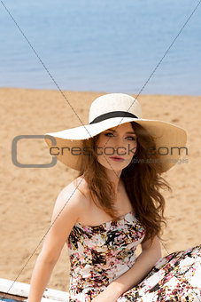 girl in summer dress on the beach