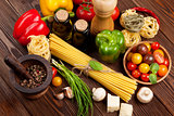 Italian food cooking ingredients. Pasta, vegetables, spices