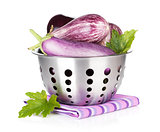 Fresh ripe eggplants in colander