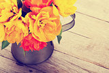 Colorful tulips bouquet in watering can. Toned