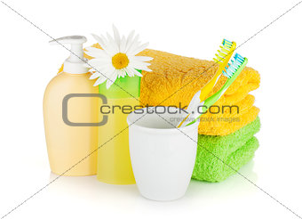 Toothbrushes, shampoo bottles, two towels and flowe