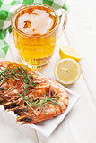 Beer mug and grilled shrimps