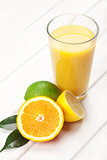 Citrus fruits and glass of juice. Orange, lime and lemon.