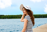 summer holidays girl on the lake white hat