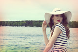 pretty girl in a commercial shot outside near sea color vintage