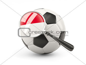 Football with magnified flag of indonesia