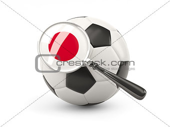 Football with magnified flag of japan