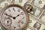 Antique pocket watch and money