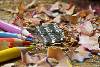 colored pencils sharpener and shavings