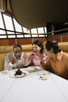 Friends eating dessert.
