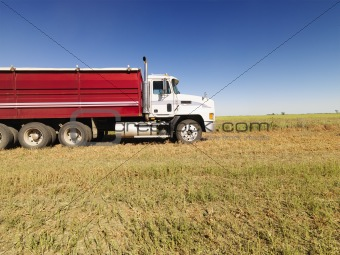 Semi truck in field.