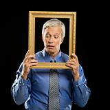 Man holding picture frame.
