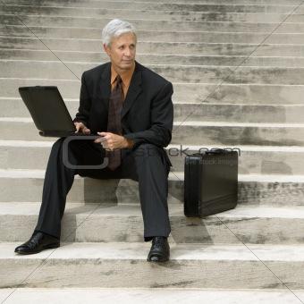 Businessman  on steps.