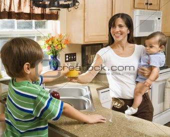Mom and children in kitchen.