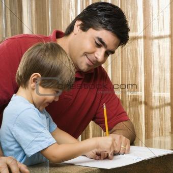 Dad helping son.