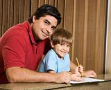 Dad and son with homework.