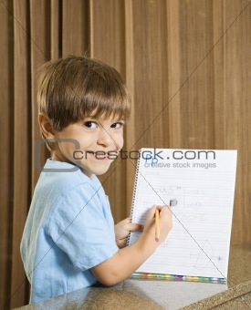 Boy showing homework.